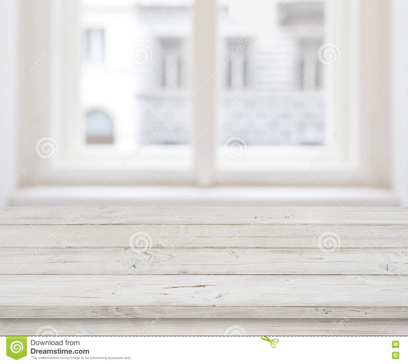Empty wooden table top for product display over blurred window
