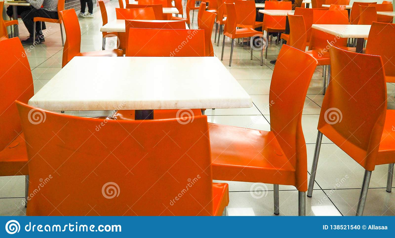 Empty Yellow Color Chairs Arranged In The Row With The Blurred People Background In The Hall Dining Room With Orange Chairs Stock Photo Image Of Furniture Bright 138521540