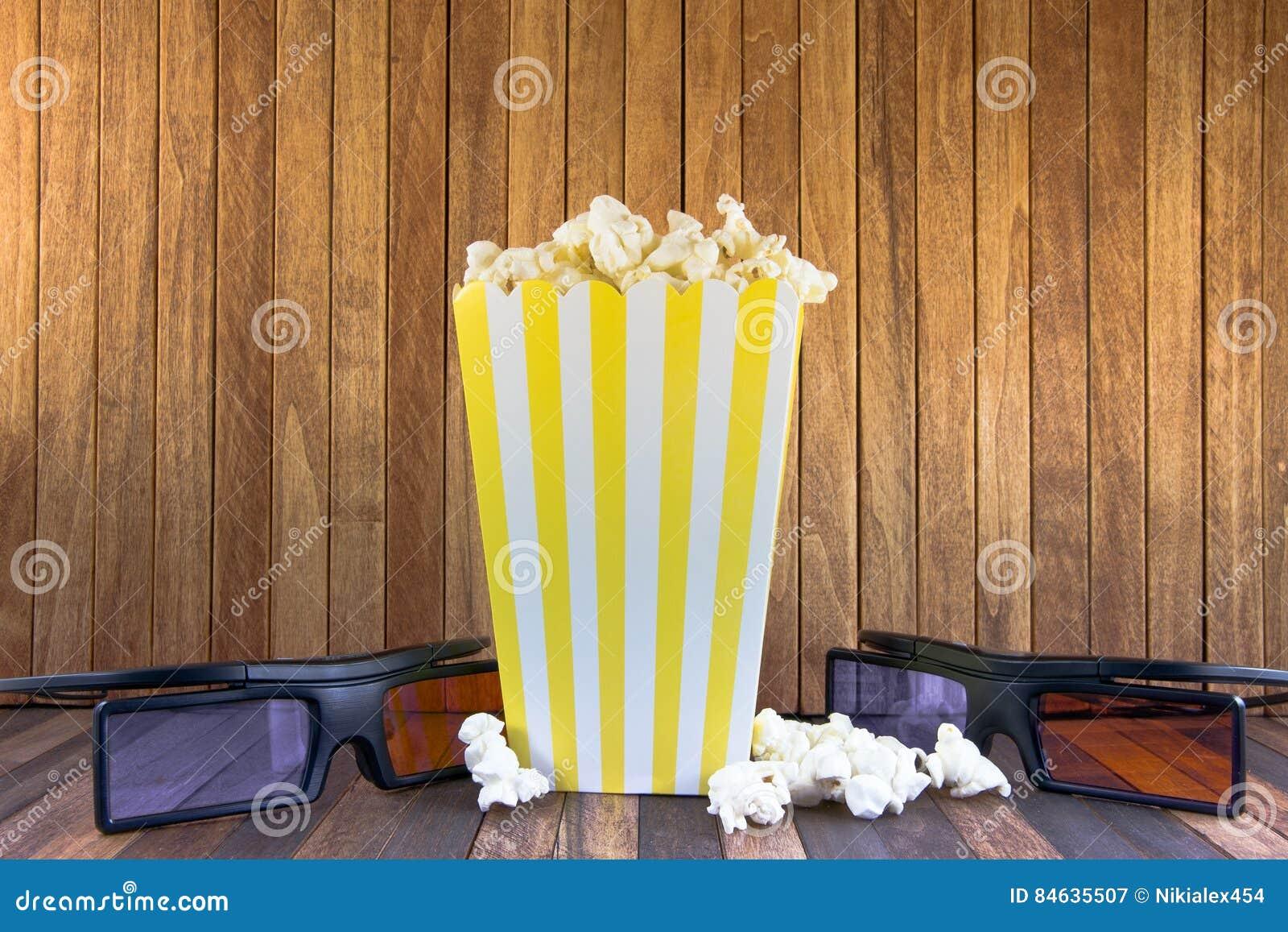 En ask av popcorn och exponeringsglas 3D