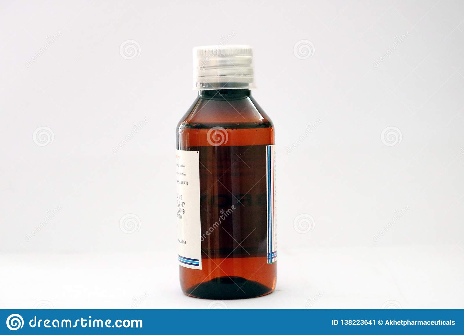 En bärnstensfärgad kulör medicinhusdjurflaska med det genomskinliga doseringlocket