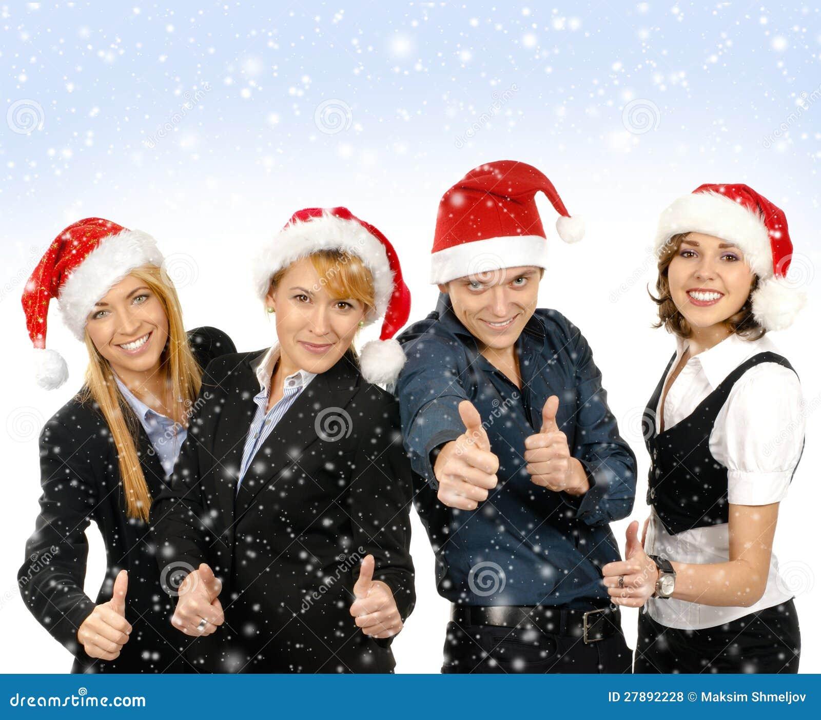 En grupp av affärspersoner i julhattar