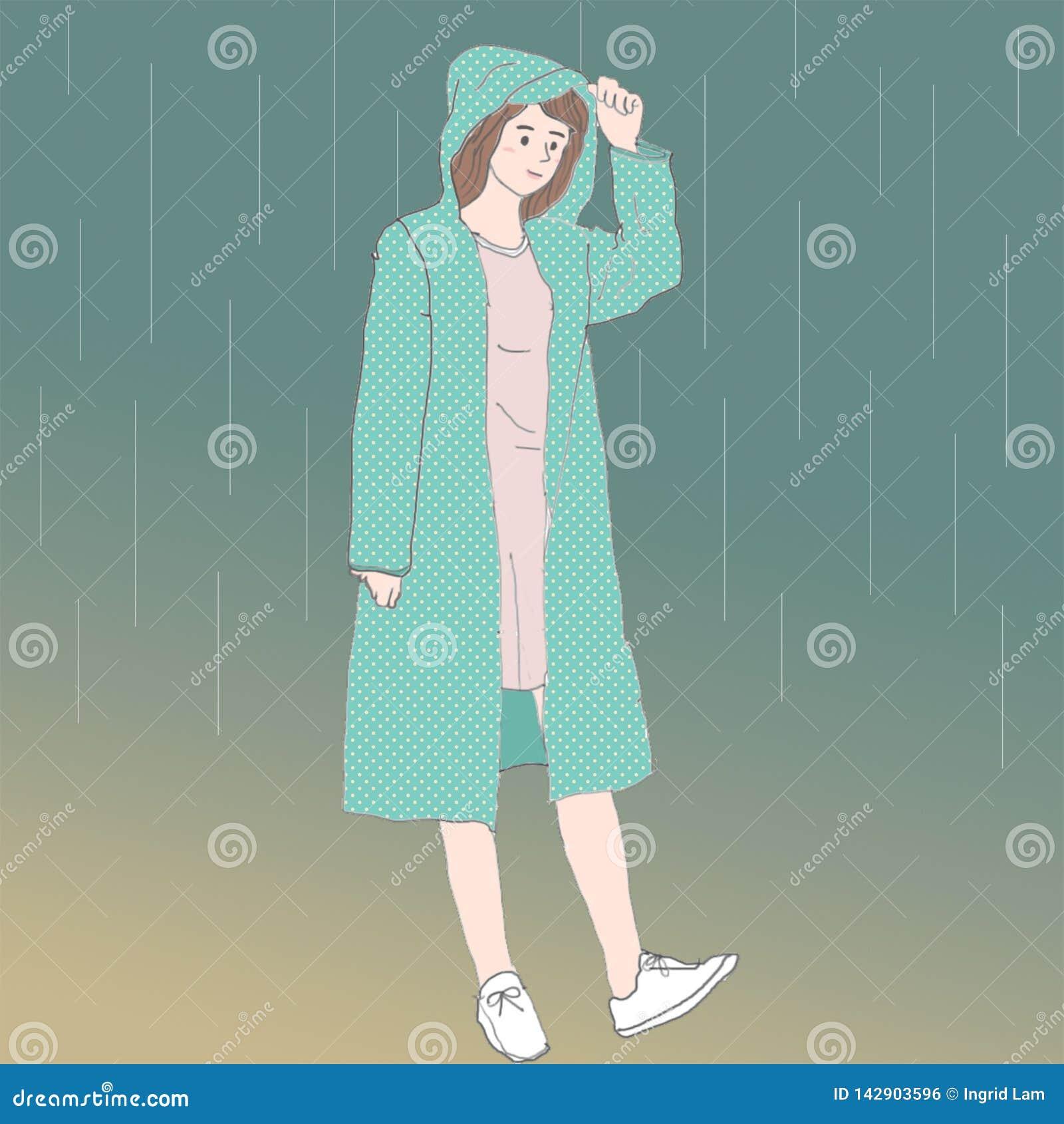En gullig asiatisk flicka med en grön regnrock