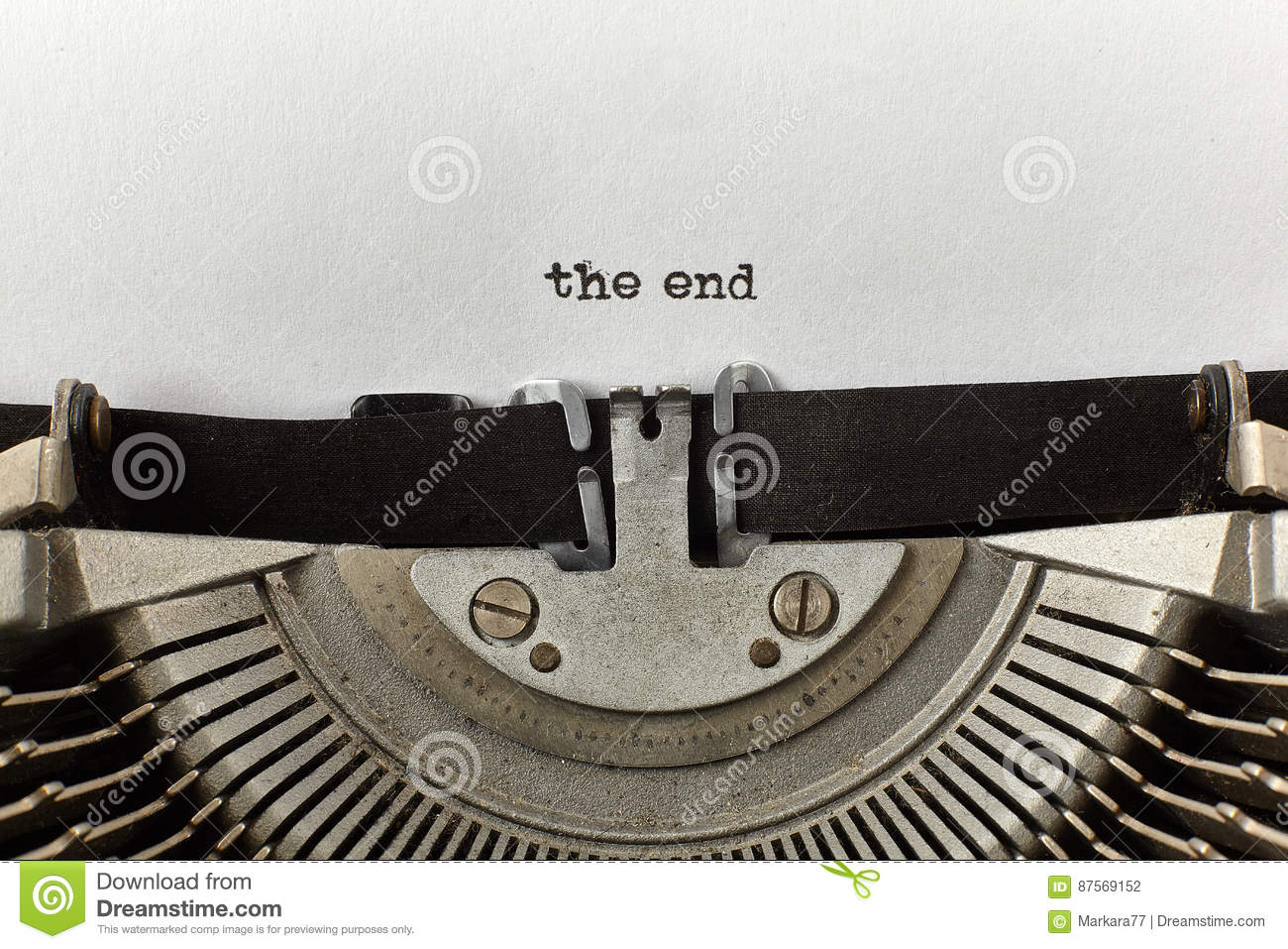 `the end` typed words on a vintage typewriter