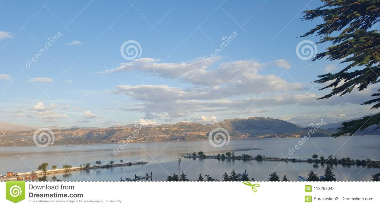 Mountains And Clouds By Lake