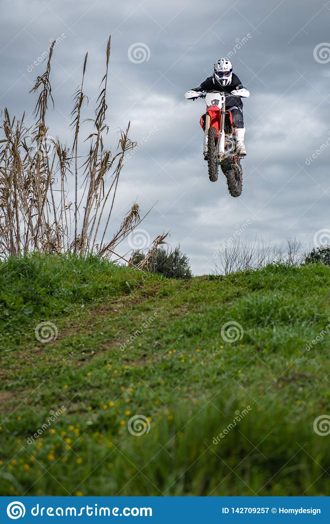 Motocross Race Mud Rider stock photo. Image of leader