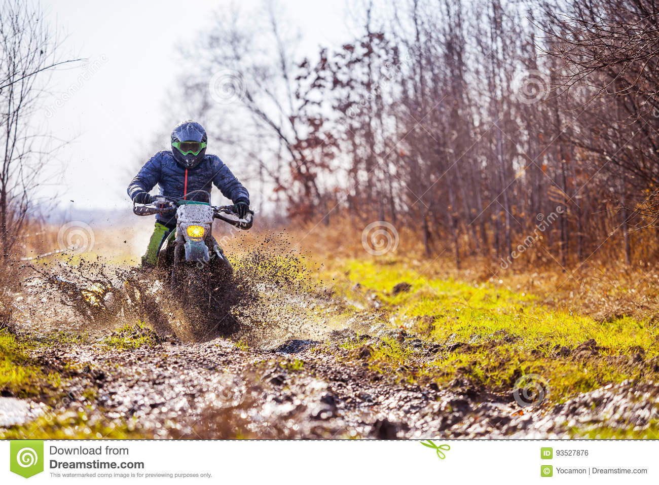 The Man On A Motorcycle Rides Through The Mud Stock Image