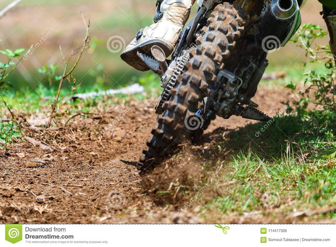 Enduro,motocross in the mud,Details of flying debris during an acceleration