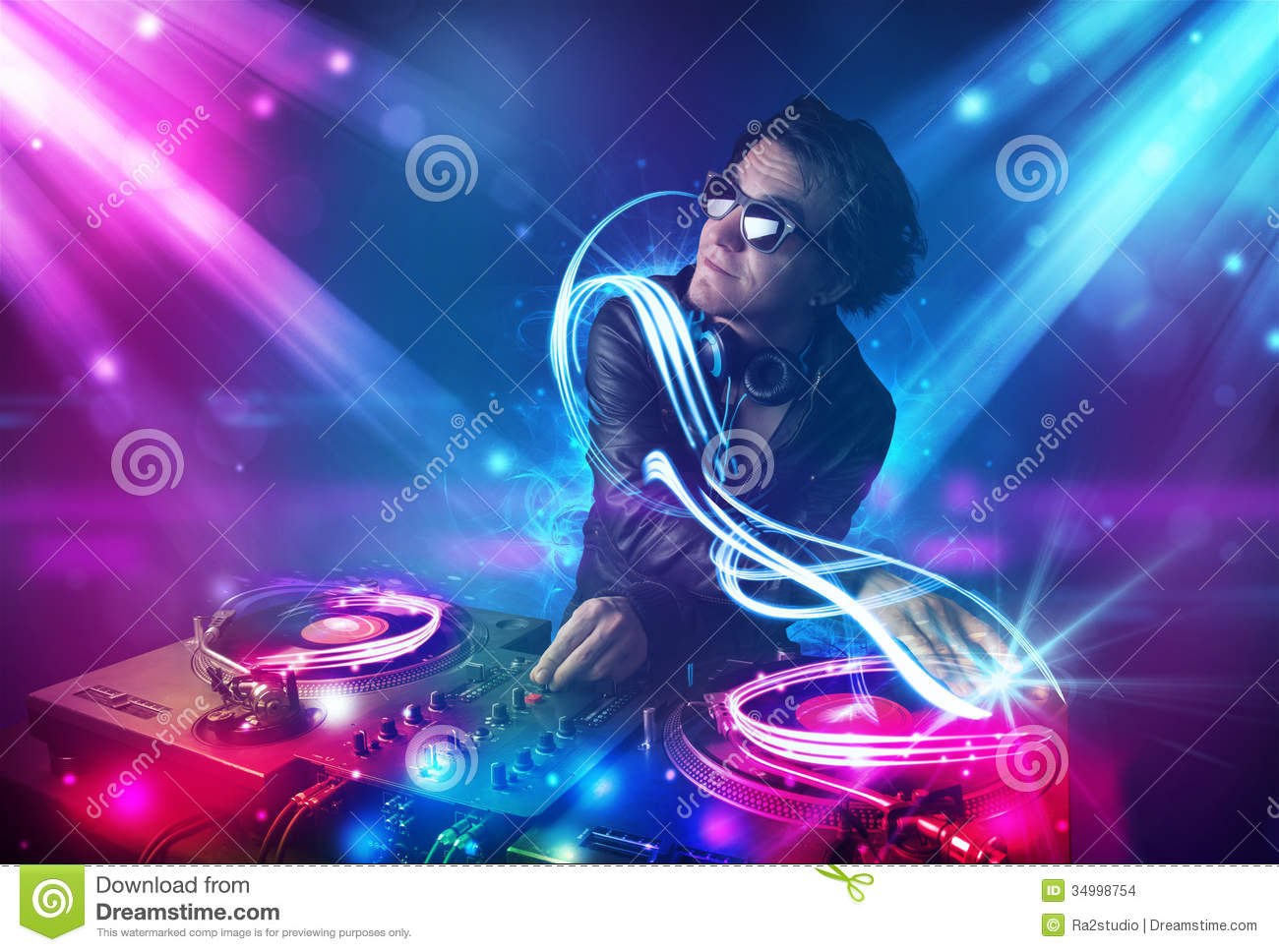 energetic dj mixing music with powerful light effects stock photo image 34998754. Black Bedroom Furniture Sets. Home Design Ideas