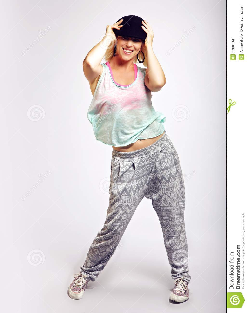 Energetic hip hop dancer in fashionable clothing royalty for Hip hop outfit damen