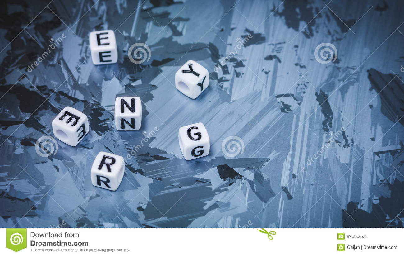 ENERGY cube letter break up randomly on solar silicon cell surface. Concept of renewable energy
