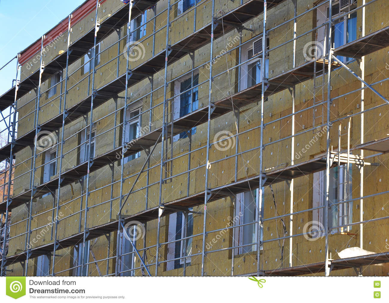 Energy efficiency house wall renovation for energy saving. Exterior house wall heat insulation with mineral wool