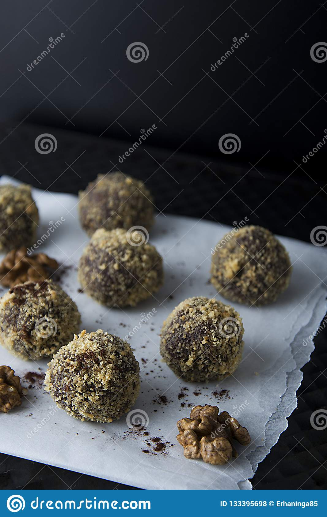 Energy healthy homemade truffles. Uncooked sweet balls made from walnuts and biscuits