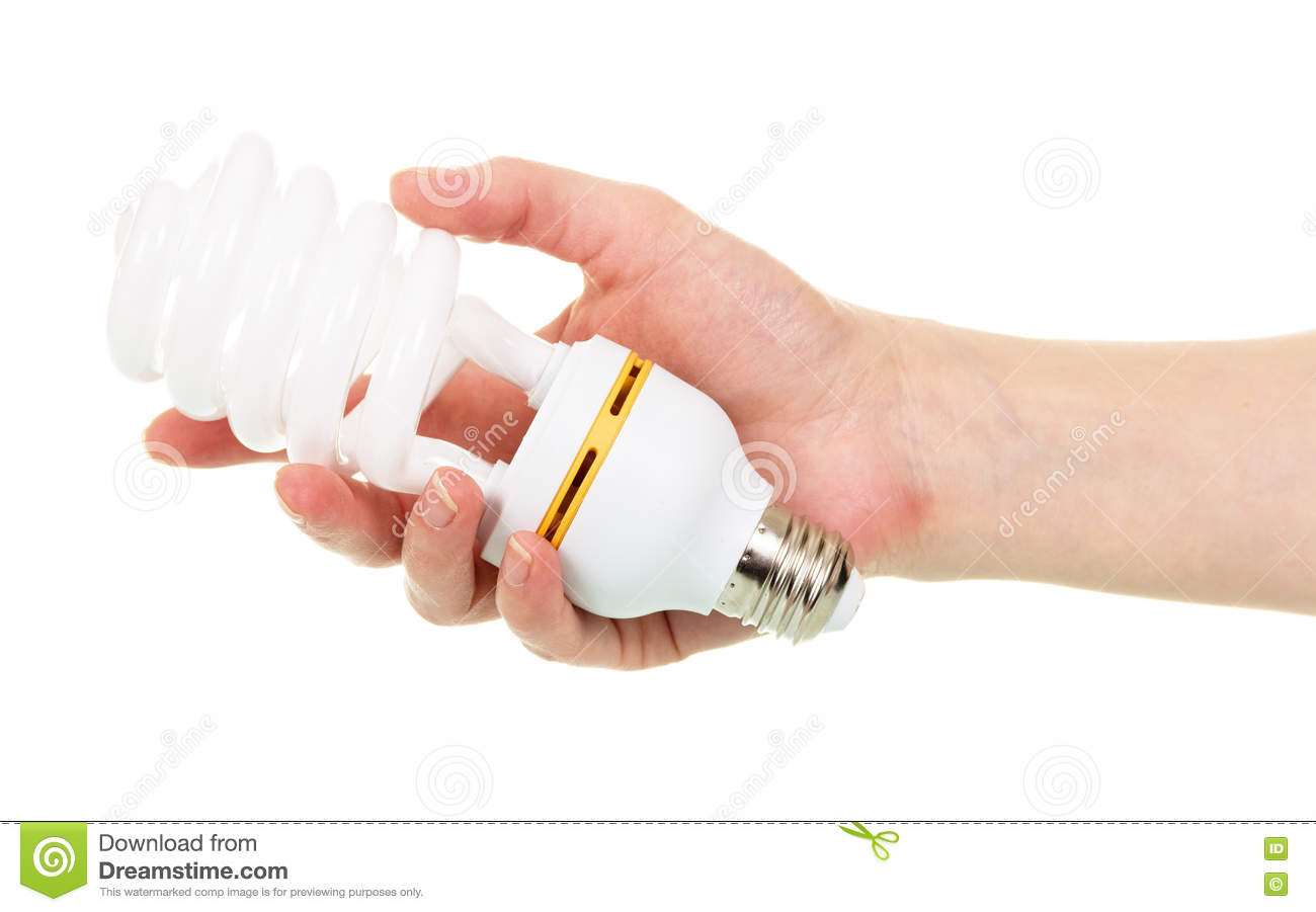 Energy-saving fluorescent spiral bulb in hand isolated on white.