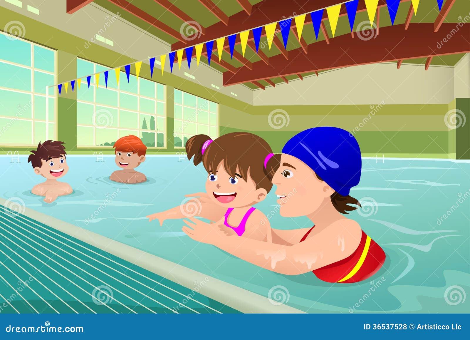 Enfants ayant une le on de natation dans la piscine d for Apprendre a plonger dans une piscine
