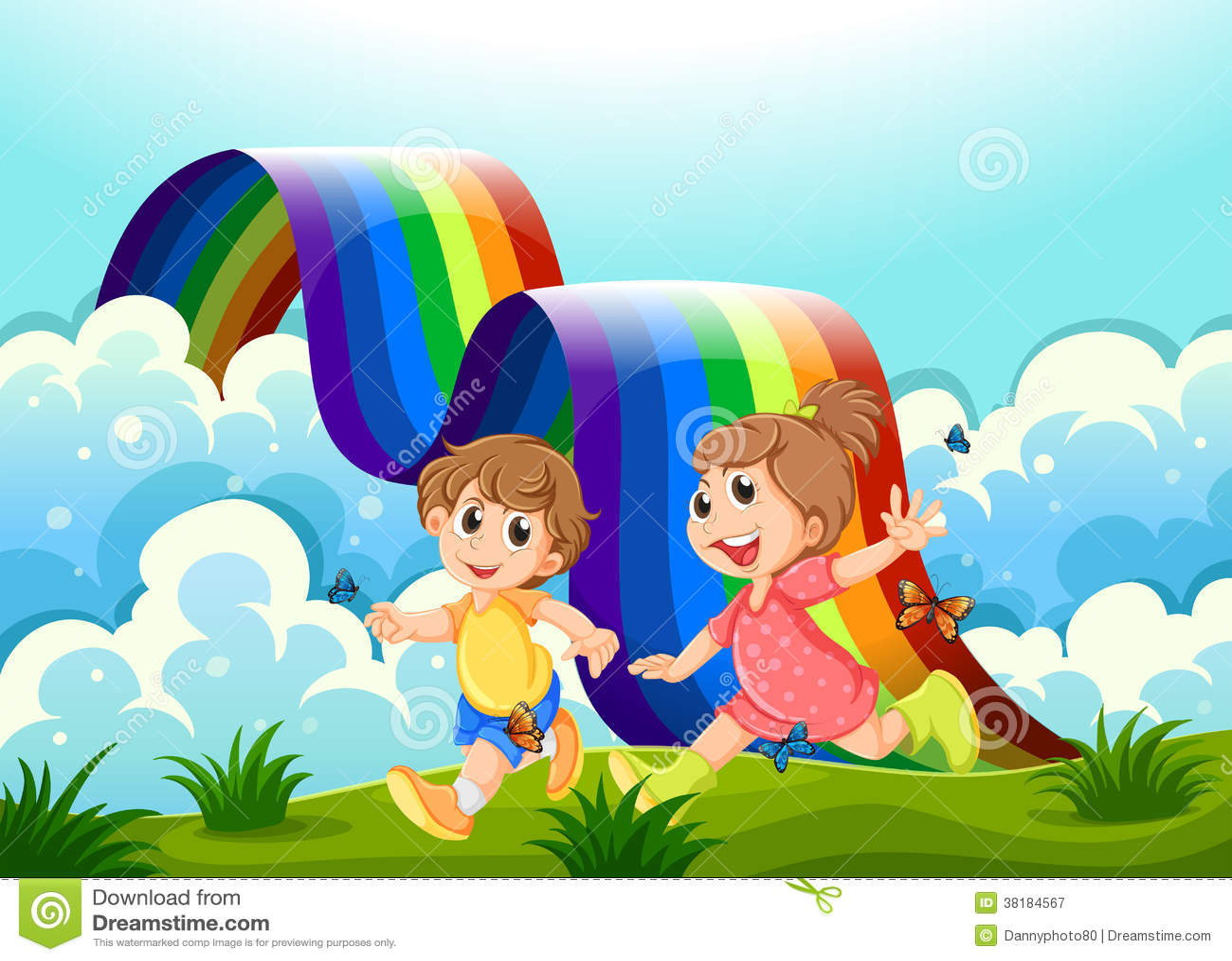 Enfants heureux jouant au sommet avec un arc-en-ciel