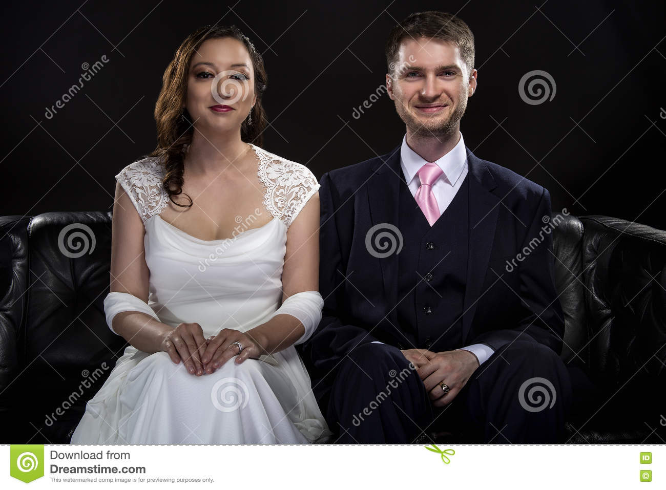 Engaged Couple Modeling Art Deco Style Wedding Suit And Dress Stock