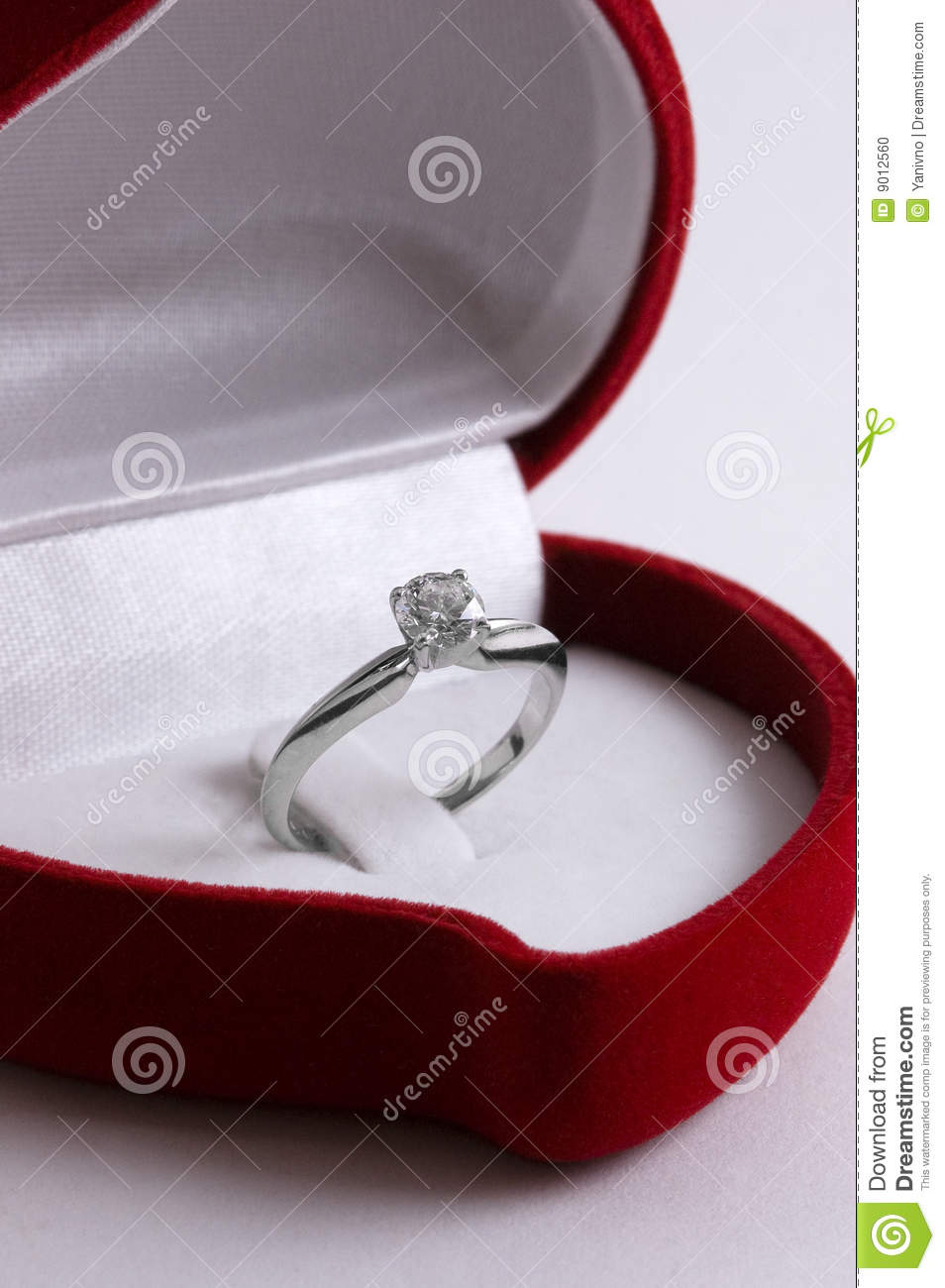 Engagement diamond ring in a red heart shaped box stock for Heart shaped engagement ring box