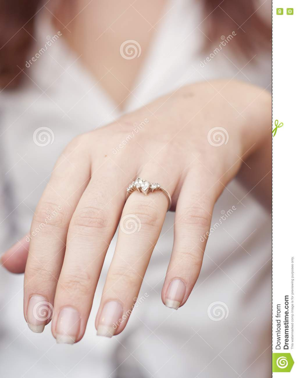 engagement ring into a finger royalty free stock images