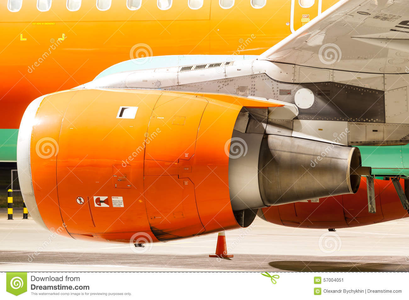 Engine of the airplane painted in orange. Close-up