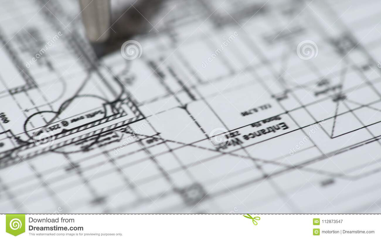 Engineer drawing detailed building plan at construction bureau