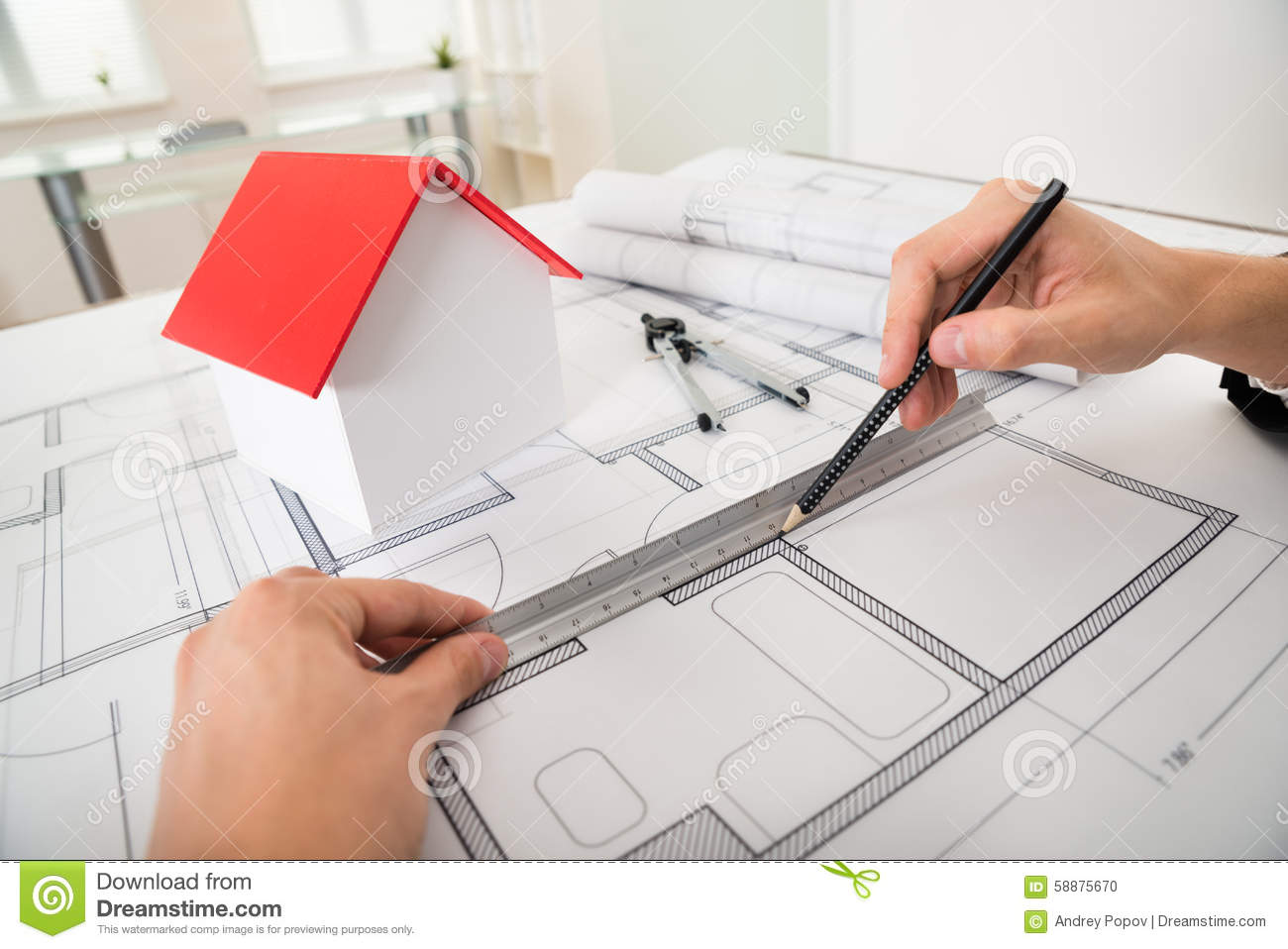 Engineer drawing diagrams on blueprint stock photo image of design close up of engineer drawing diagrams in front of house model on blueprint ccuart Image collections