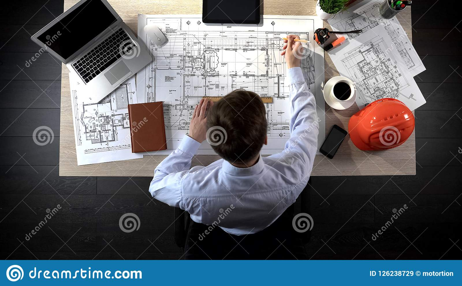 Engineer drawing plan of building, safety engineering, office location planning