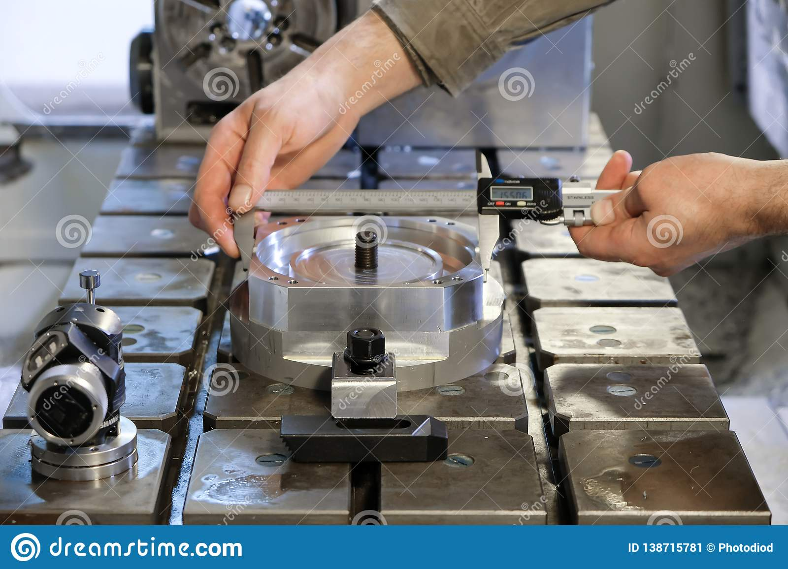 Engineer In Factory With Apprentice Checks Component Quality.Electronic caliper