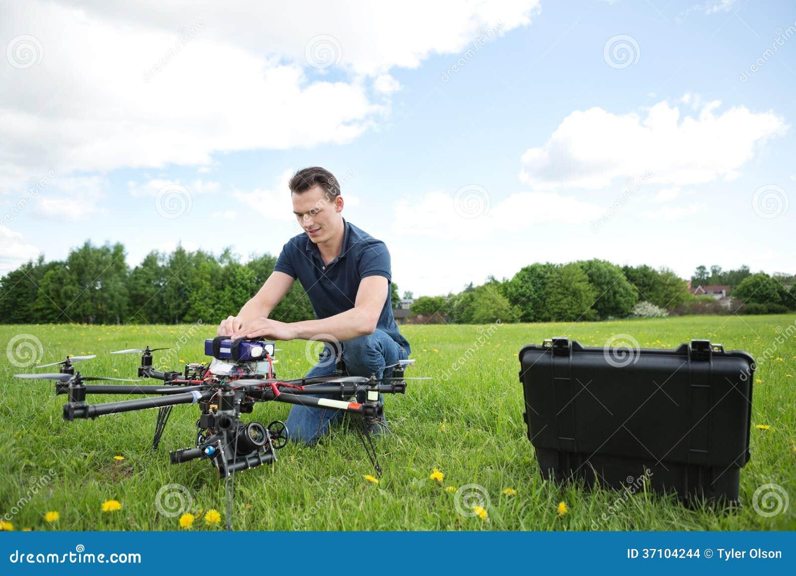 Engineer Fixing UAV Drone in Park