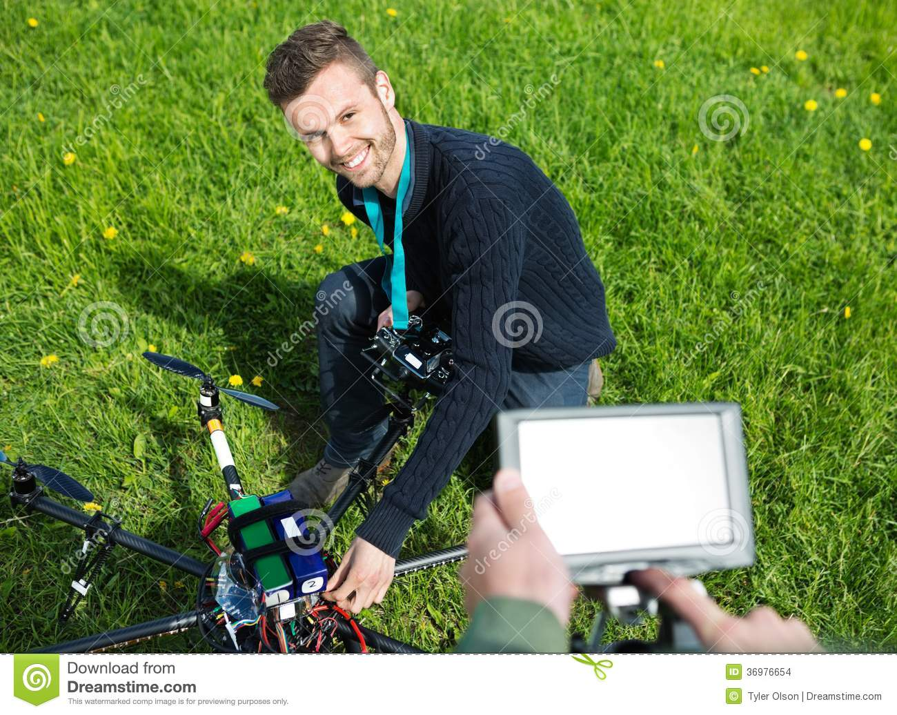 Engineer Fixing UAV Helicopter in Park