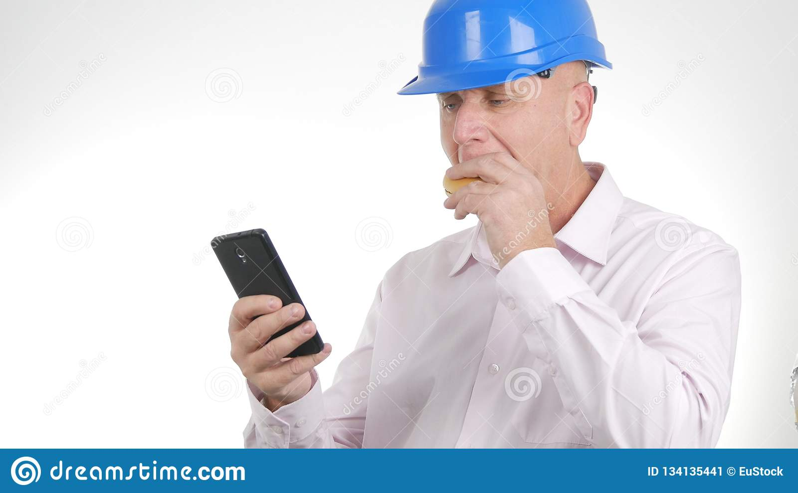 Engineer Image Eating a Sandwich and Text Using Mobile Phone