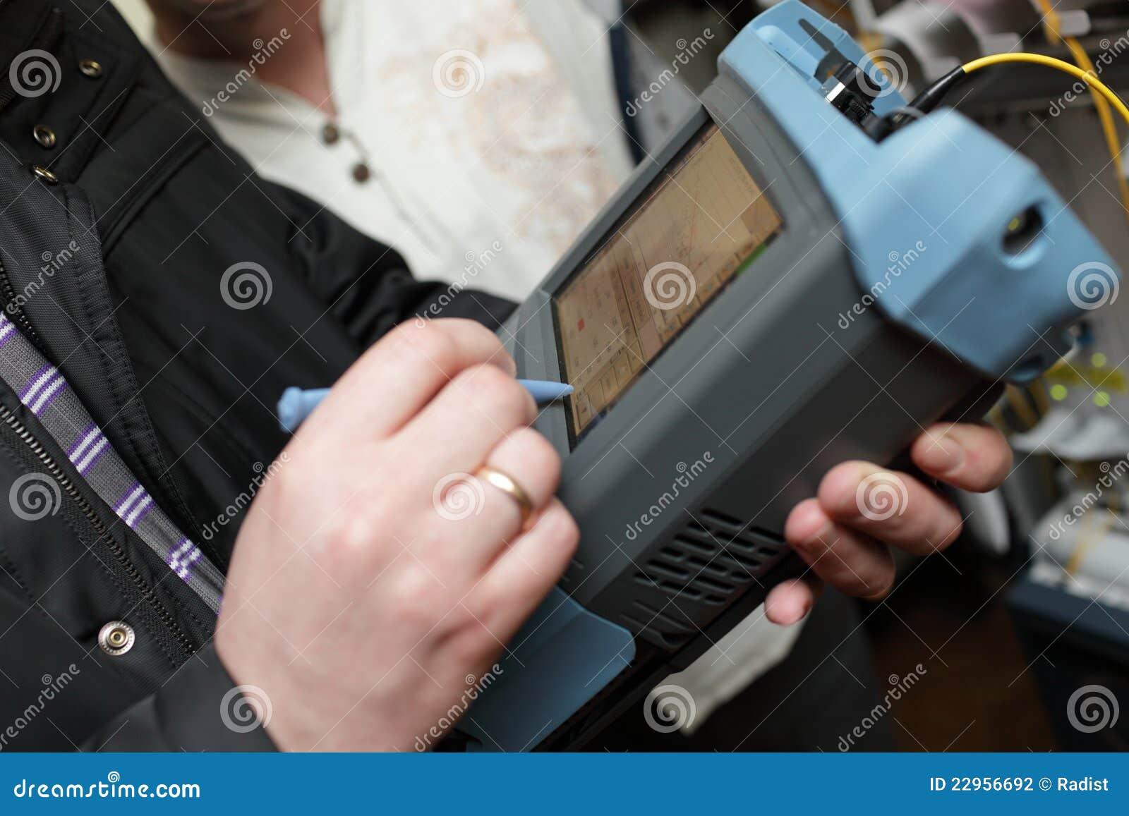 Engineer Measuring Fiber Optic Stock Photo - Image of ...