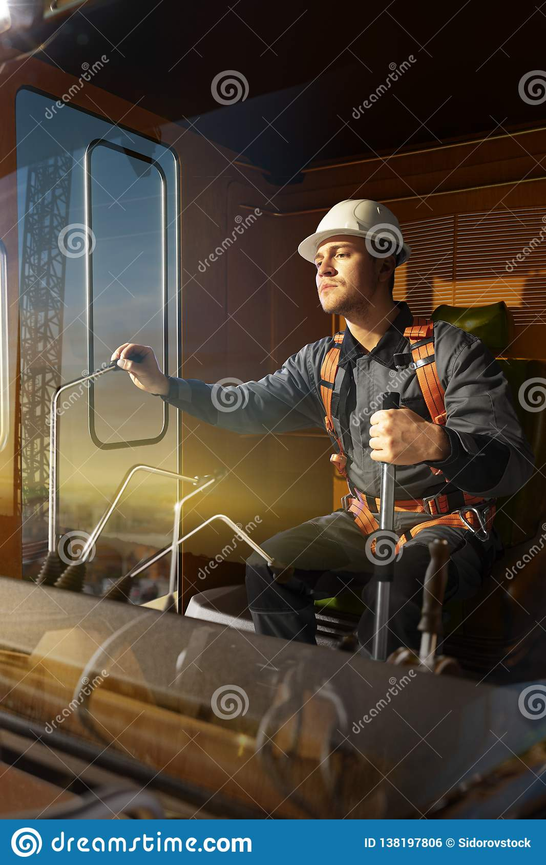 Engineer operator crane in action . He sit a top in crane cabin and working