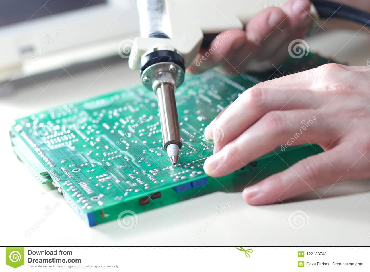 Engineer Repair Circuit Board With Electric Vacuum Solder Sucker How To A