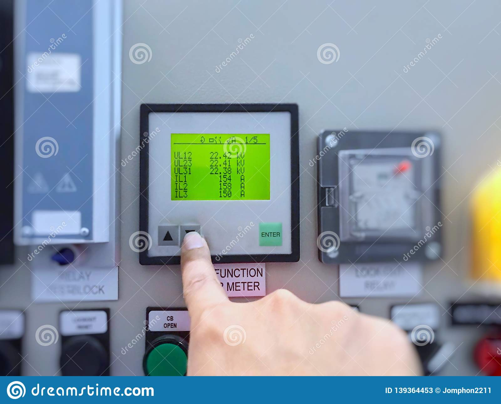 Engineer`s hand check power meter parameter of voltage current watt hours in electric high voltage control building of power plan