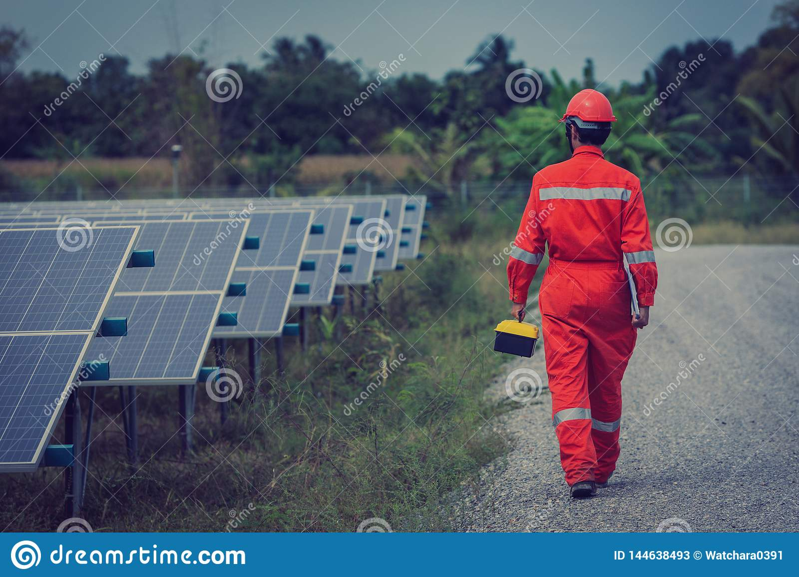 engineer working on installing solar panel ; operation of solar power plant by smart operator