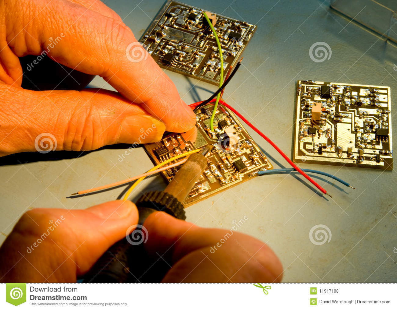 engineer soldering wires to a circuit board stock photo image of rh dreamstime com