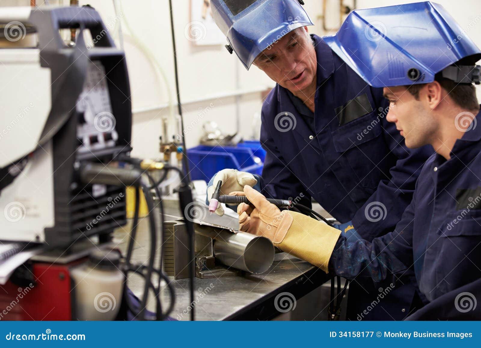 Engineer Teaching Apprentice To Use TIG Welding Machine Royalty ...