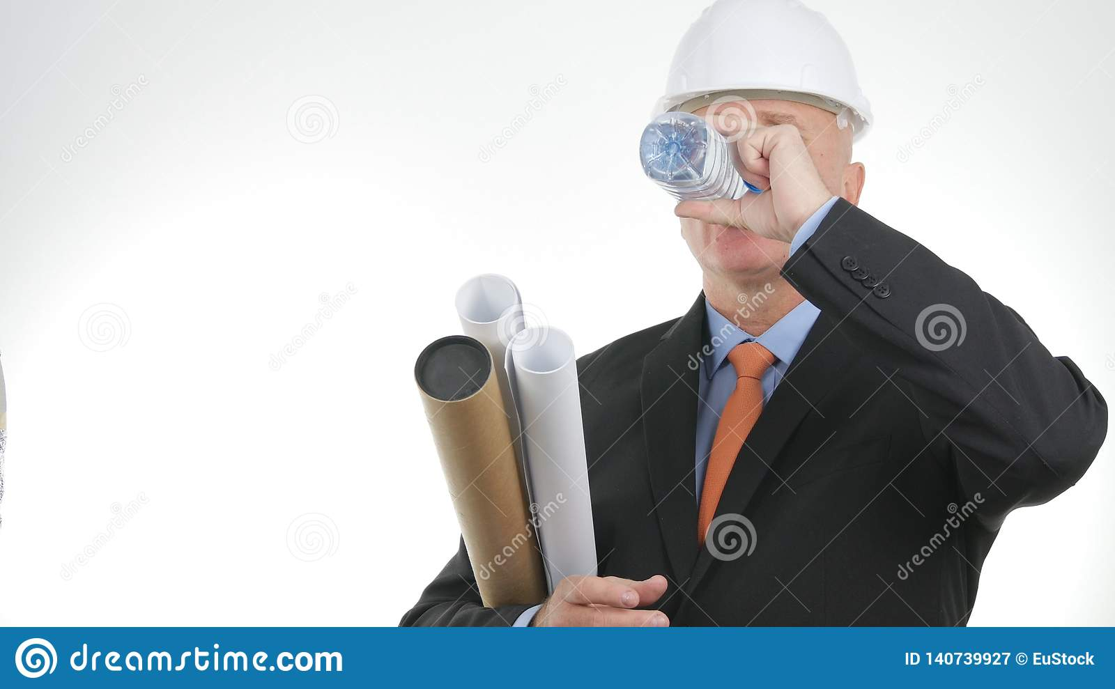 Engineer with Technical Plans and Building Projects Drinking Fresh Water
