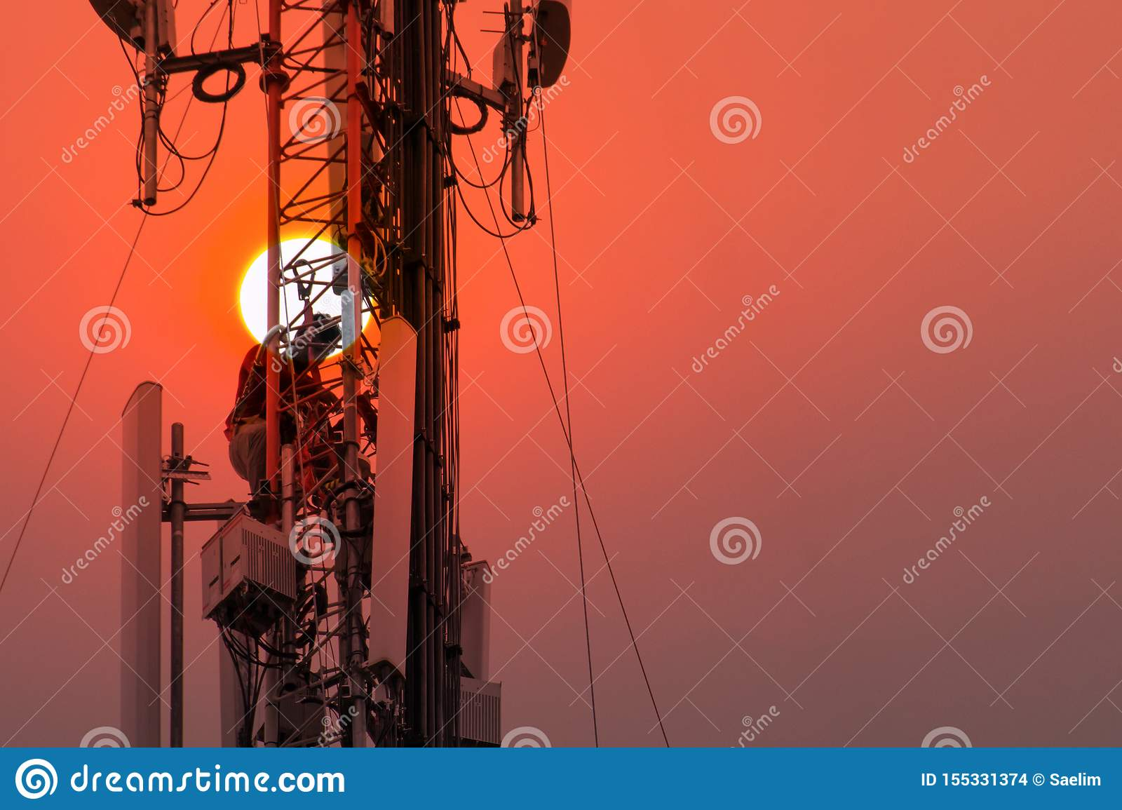 Engineer or Technician working on high tower,Risk work of high work, people are working with safety equipment on tower,