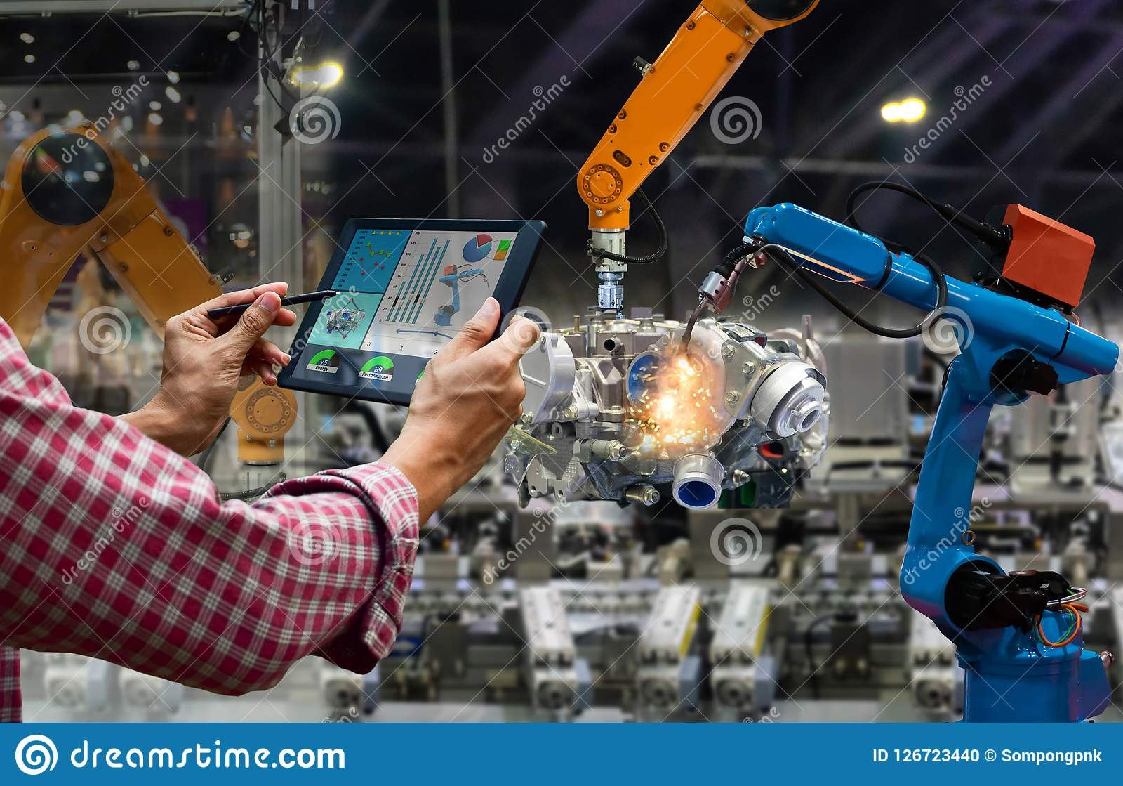 Engineer touch screen control robot the production of factory parts engine manufacturing industry