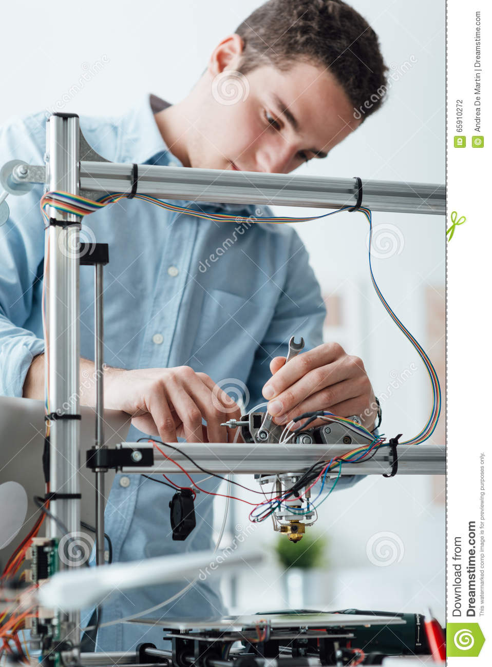 Engineer working on a 3D printer