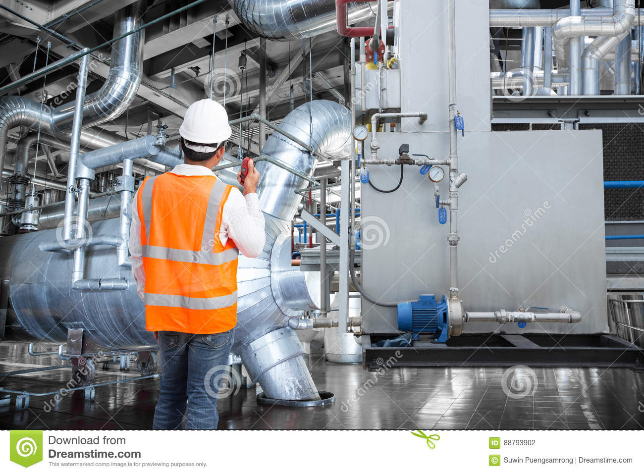 engineer working in a thermal power plant with talking on radio - Power Plant Engineer