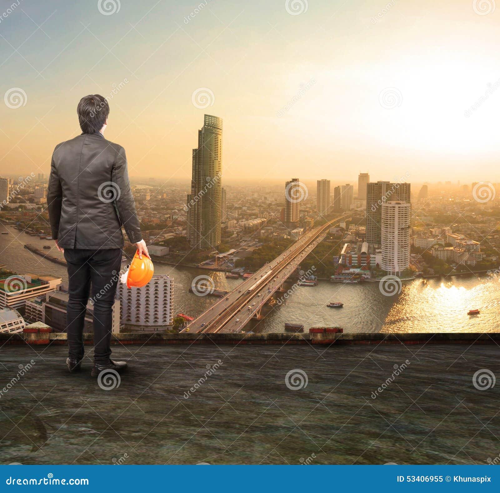 Engineering Man Standing On Top Of Building Looking To