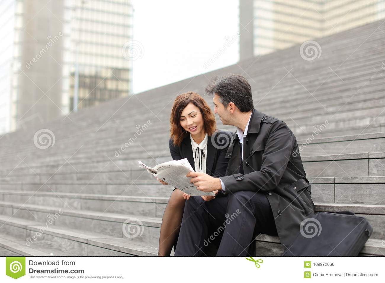 engineers male and female reading article about company in