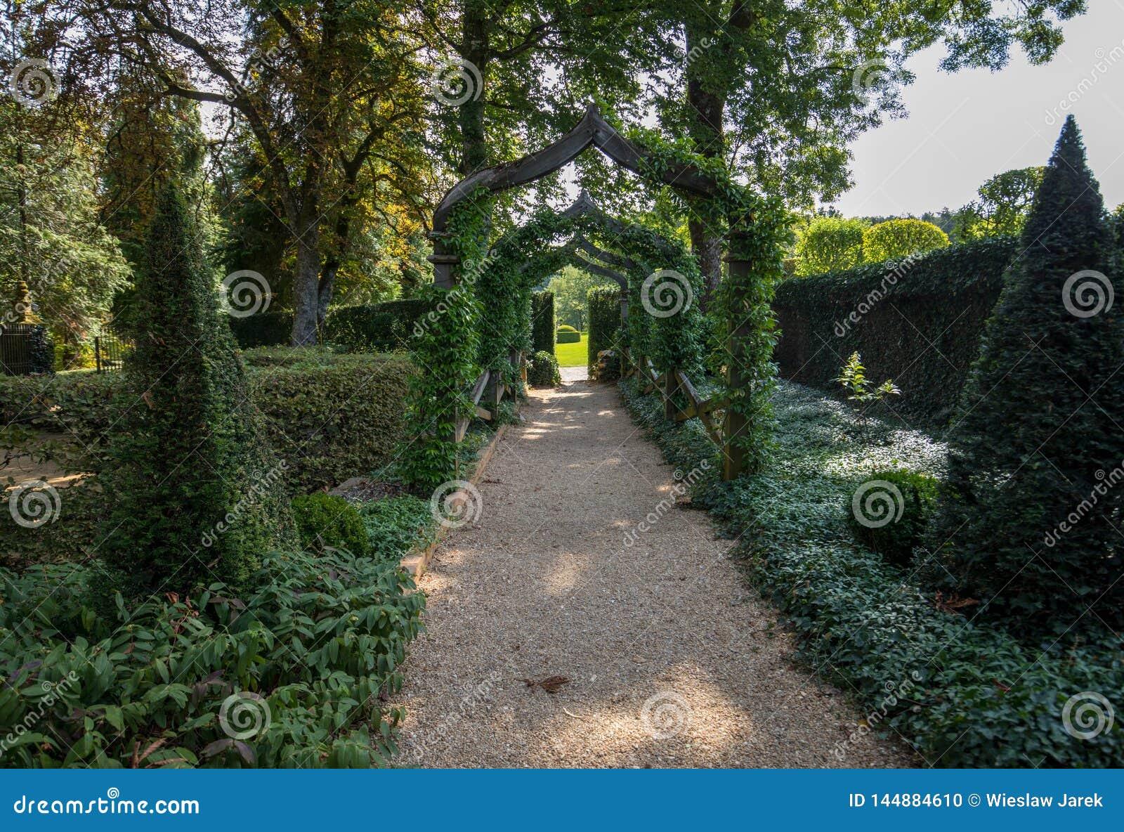 English arcade in the picturesque Jardins du Manoir d Eyrignac in Dordogne