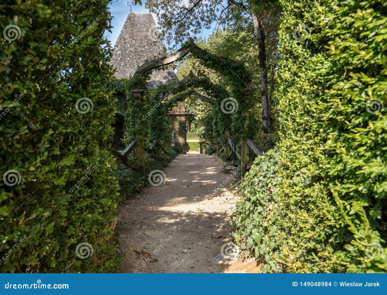 English arcade in the picturesque Jardins du Manoir d Eyrignac in Dordogne.
