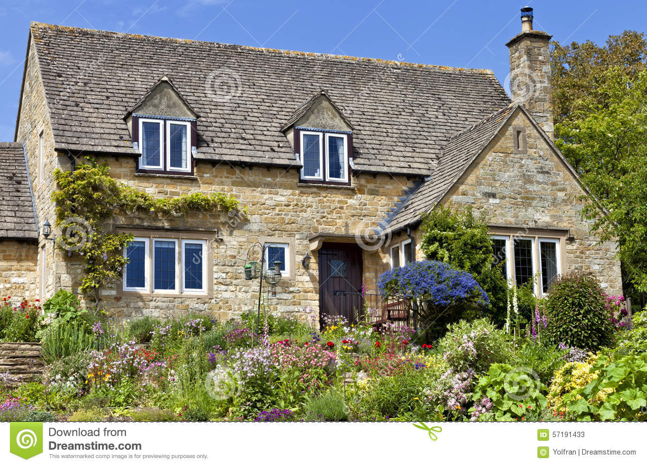 English Cotswolds Cottage With Flowering Summer Garden
