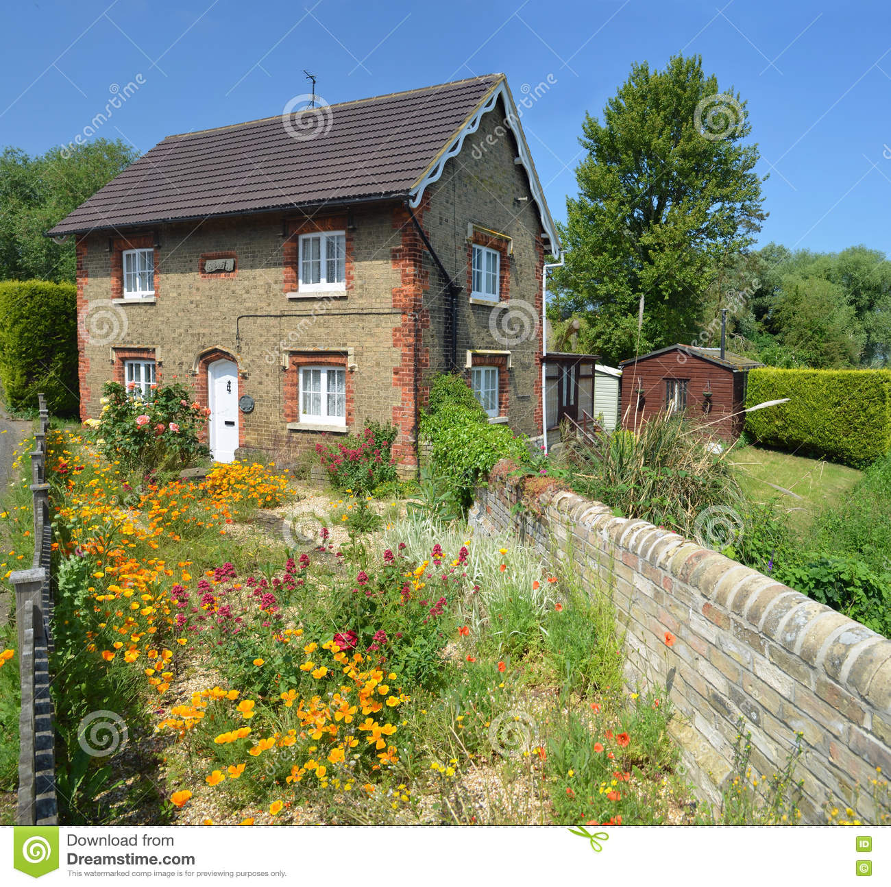 English Cottage With Colourful Cottage Garden And Wall