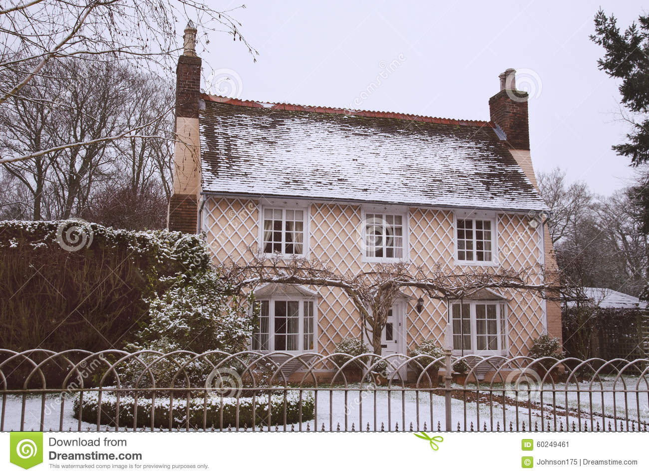 English country cottage in the winter snow stock image for Cottage anglais