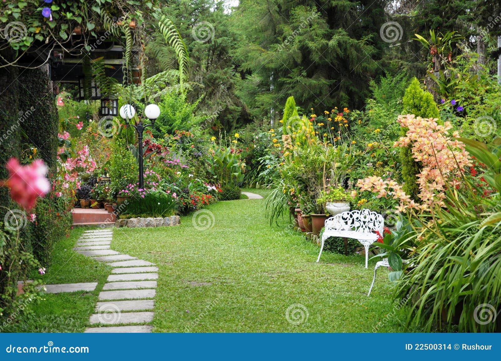 Beautiful English country garden featuring brick side walk, white ...